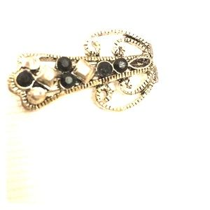 Stylized black and silver vintage scatter pin